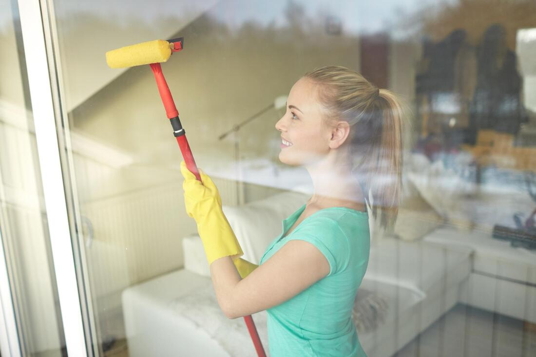 interior window cleaning near me. Woman cleans interior windows!